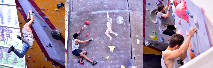 Climbers on bouldering wall and climbing tower